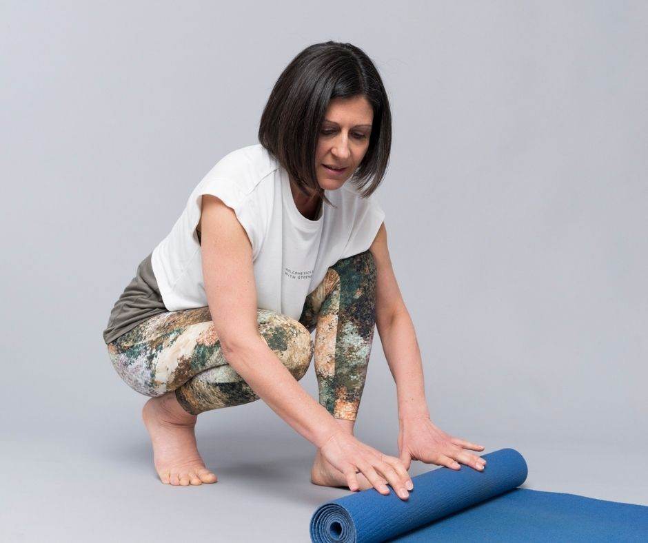Angie unrolling yoga mat
