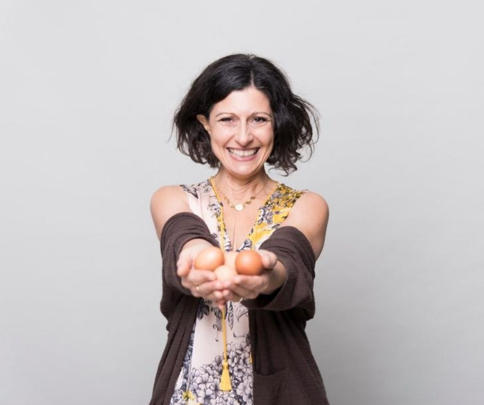 Woman holding eggs.