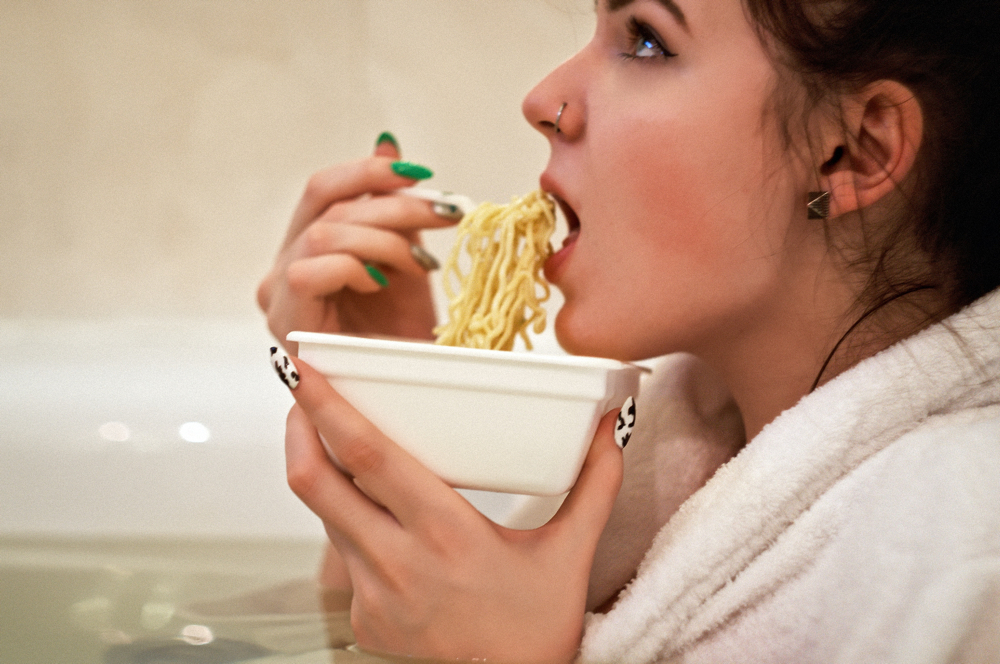 Woman eating noodles.