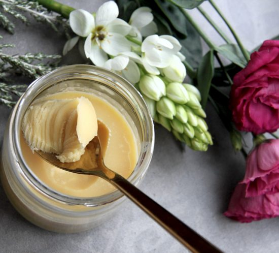 Butter in a glass jar with flowers.