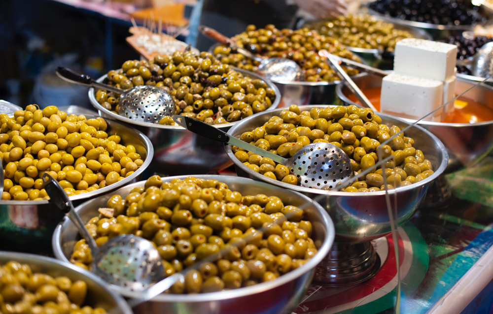 Olives for sale in bowls.