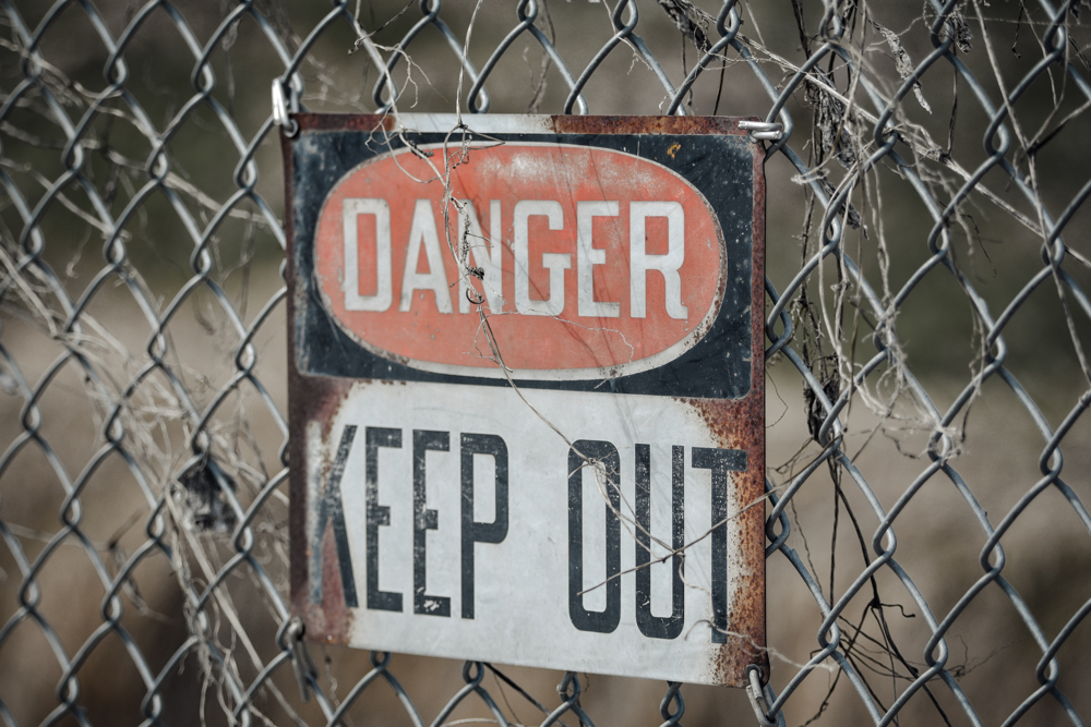 """""""Danger: Keep out"""" Sign."""
