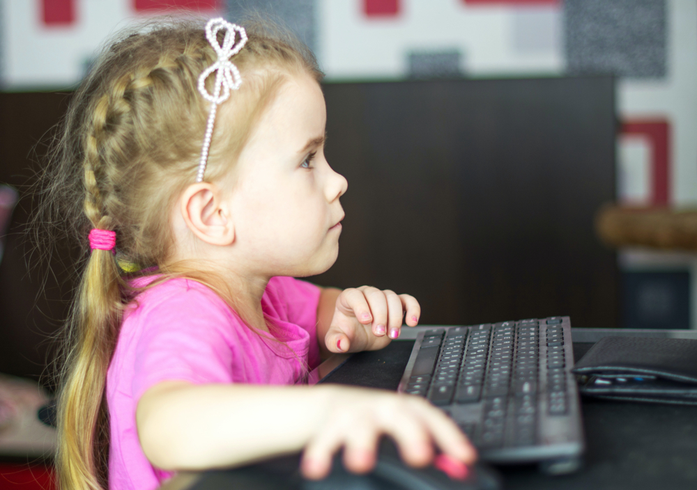 Child with computer.
