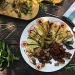 Antipasto platter with sundried tomatoes, grilled zucchini and caperberries.