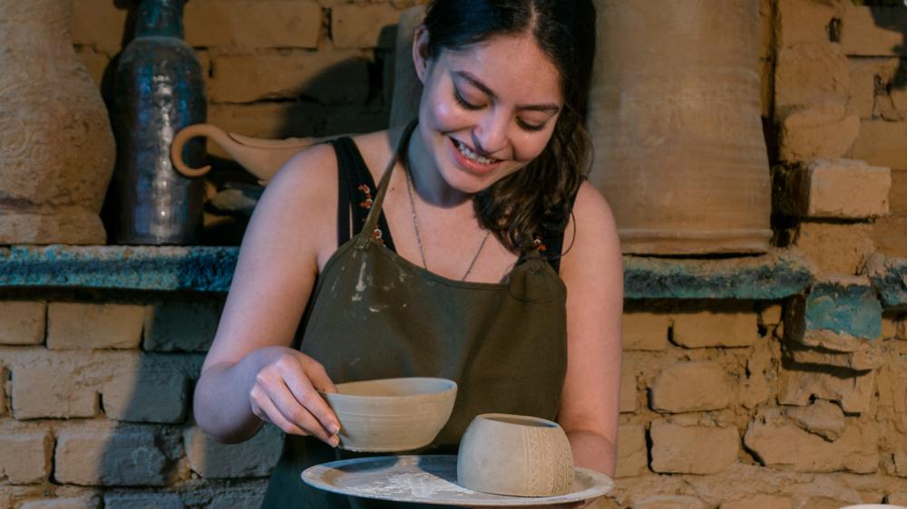 Woman making pots.